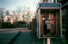 (toulouse goose) Tags: film agfa vista 400 35mm canon eos elan7 ef50mm18 c41 homedeveloped epson v500 telephone payphone bell endangeredspecies spring grandbend ontario parking lot sunset