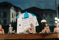 Beach Ladies (35mm) (jcbkk1956) Tags: ladies beach swimwear bikinis polkadot dolls toys souvenirs shop seaside deal kent film 35mm analog pentax k1000 agfa200 manualfocus ricoh 50mmf2 rikenon reflection window umbrella parasol worldtrekker girls