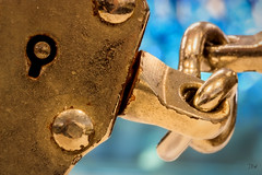 Macro Monday ~ Crime (Jan Whybourne) Tags: macromonday crime cuffs metal blue steel bokeh lock wrist