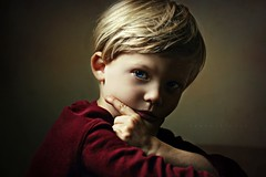 Le Penseur (Kapuschinsky) Tags: portrait portraiture childportrait child warm red naturallight chiaroscuro sidelight dramatic emotive sonyalpha sonyphotography sonyphotographing minolta closeup intense lepenseur kapuschinsky color