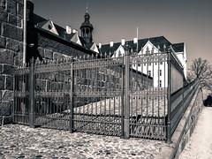 behind closed bars (claudia.kiel) Tags: plön schloss castle castlehill gebäude building architektur architecture gitter bars zaun fence sepia monochrome einfarbig