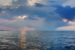 Moody Sodus Sunset Sky (matthewkaz) Tags: lakeontario lake water soduspoint sodusbay sodus greatlakes sky clouds newyork sun sunset stormy reflection reflections 2010