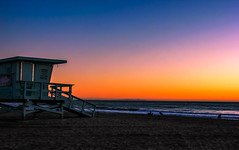 Santa Monica | Lifeguard House (fastarmaan) Tags: california blue winter light sunset sky orange usa sun house west beach water colors cali one coast losangeles sand december alone purple pacific santamonica famous horizon lifeguard shore single fading cloudless southerncalifornia westcoast beachfront 2012 colorshift lifehouse