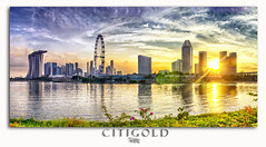 CitiGold (Ashley Teo (PilotPotato)) Tags: blue urban panorama beautiful architecture clouds buildings reflections landscape lights golden evening bay nikon singapore glow cityscape slow dusk magic wide dramatic wideangle scene architectural hour shutter epic blending d7000