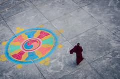 Buddhist monk, Hemja, Nepal (Andrew Taylor Photography) Tags: nepal walking education religion monk buddhism fromabove negativespace monastery tibetan colourful mustang pokhara planview sakya tibetanbuddhism monastics hemja photographytechniques pematsalsakyamonasticinstitute pematsalmonastery