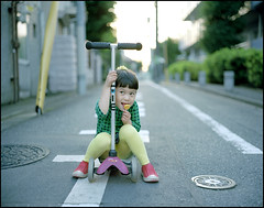 Lollipop. (MichelleSimonJadaJana) Tags: portrait color 120 girl childhood japan analog children tokyo kid portable scanner documentary lifestyle rangefinder snaps jana  epson medium format  nikkor f28 67 compact flatbed jada 80mm plaubel makina vuescan v750 gtx970