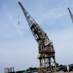 old crane (beta karel) Tags: old blue sky square harbor belgium cloudy crane antwerpen 2013 betakarel