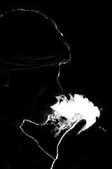 Smoke And Desert...! (Nitish Bindal Photography) Tags: nightphotography travel canon smoke streetphotography camel backlit turban smokingkills pushkar silhoutte gettyimages travelphotography traveldiary cameltraders camelfair pushkarfair cameltrader nitishbindalphotography cameltradefair