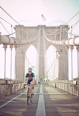 Crossing the bridge, New York (belthelem) Tags: nyc trip travel bridge sunset usa ny newyork bicycle brooklyn sunrise puente nikon tour manhattan ciclista bici nuevayork cruzar puentebrooklyn d700