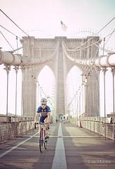 Crossing the bridge, New York (belthelem) Tags: nyc trip travel bridge sunset usa ny newyork bicycle brooklyn sunrise puente nikon tour manhattan ciclista bici nuevayork cruzar puentebrooklyn d700