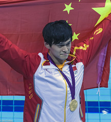 Chinese Celebration (f0rbe5) Tags: china uk greatbritain blue red sun white london yellow swimming gold freestyle catchycolours flag chinese posing medal yang photographs swimmer prc olympics athlete day8 goldmedal olympicpark stratford celebrating array 2012 ssp olympicgames goldmedallist medallist worldrecord london2012 olympian peoplesrepublicofchina chineseflag aquaticscentre 1500m sunyang worldrecordbreaker 1500mfreestyle xxxolympiad