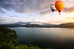 Hot air balloons floating over lake (Patrick Foto ;)) Tags: morning travel blue sunset summer vacation sky cloud mountain lake hot color reflection tree tourism nature water beautiful sport festival clouds sunrise river balloons landscape asian thailand freedom flying nice pond colorado colorful asia view natural dam background air hotair balloon floating sunny grand tourist aerial national transportation thai ballooning suratthani khaowong