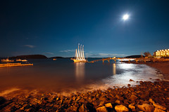 Bar Harbor full moon (and pretty sail boat), Maine (Sebastian Anthony) Tags: ocean longexposure blue sea orange moon water night stars boat lowlight rocks harbour maine fullmoon barharbor themargarettodd