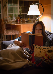Late Night Reading. (cjcmarquez) Tags: reading lowlight 50mmf14 goodbook canon6d vision:people=099 vision:face=099 vision:outdoor=0525 vision:sky=0592