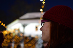 Enjoying the night #Flickr12Days (In my hands they crumble) Tags: red england london hat sarah night lights december dof bokeh iceskating watching depthoffield wife hydepark bandstand 7th winterwonderland 2013 flickr12days