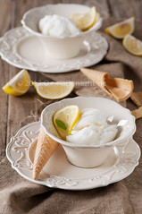 Lemon ice-cream (Oxana Denezhkina) Tags: summer food white cold macro ice cup yellow closeup ball dessert milk lemon cool flavor sweet background cream mint tasty bowl delicious freeze icecream gelato vanilla taste product refreshing sorbet scoop sundae creamy