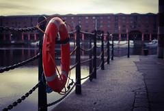Lifebuoy (hobbitbrain) Tags: uk red england liverpool dock albert railing lifebuoy mersey albertdock