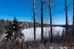 Bead Lakes, Riding Mountain National Park, Manitoba, Canada (Warren Justice) Tags: trees winter wild vacation sky sun lake snow canada cold beautiful forest landscape outdoors daylight frozen photo high cool bush scenery poplar view hiking snowy hill sunny wideangle bluesky scene canadian manitoba depthoffield f16 trail handheld environment snowshoeing canon5d 24mm wilderness wintertime northern nationalparks coldweather spruce climate ridingmountainnationalpark clearsky snowcovered snowscene winterscape parkscanada wintery ridingmountain winterscene canoneos5d whitespruce canon24mmf14 winterphotography snowybranches winterrecreation travelmanitoba manitobatourism coldclimate snowshoetrail winteryscene stoppeddown canadianlakes canadiannationalparks winterpicture canadianwilderness beadlakes beadlakestrail fourthbeadlake