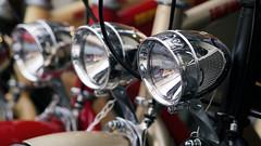 Shiny, shiny headlights (Eric Flexyourhead) Tags: city light urban detail lamp bike bicycle japan metal shop tokyo store shiny display bokeh line chrome repetition   headlight 169 setagaya shimokitazawa fragment shimokita 75mm   setagayaku zd olympusem5 mzuikodigital75mmf18
