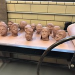 Sculptures of heads displayed in the art department.
