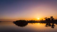 Sunset at rawal lake Islamabad (hamzaqayyum) Tags: sunset lake reflections landscape islamabad pakistan silhouette tokina dawndotcom island sun sky orange nature nikon d5200