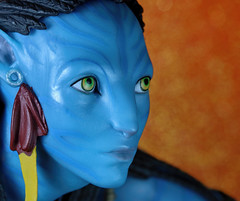 "Neytiri (Avatar) (*Millie* ""Catching up slowly"") Tags: neytiri avatar movie plastic indoor tabletopphotography macro macromondays orangeandblue toy collectible paperbackground orange blue glitter fantasy"