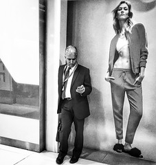 Standing with style. (-Faisal Aljunied - Bye !!) Tags: advertisement poster blackandwhitestreet standingstyle juxtaposition streetphotography iphone6 faisalaljunied