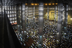 Kneeling in Prayer (Trent's Pics) Tags: istiqlalmosque devout indonesia islam istiqlal jakarta kneel koran mosque muslim people prayer quran