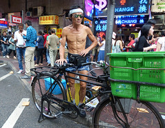 Dragon Entries (Andy WXx2009) Tags: streetphotography bicycle man china asianman asia brucelee muscles shorts hongkong candid body flesh sunglasses urban shopping basket street market crowd outdoors