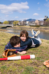 young athlete couple lying on grass together after playing baseball (Apricot Cafe) Tags: img27959 2024years asia asianandindianethnicities japan japaneseethnicity kyotocity kyotoprefecture sigma35mmf14dghsmart athletes baseball bat carefree casualclothing charming cheerful citylife couplerelationship dating day enjoyment freedom friendship fulllength glove grass happiness kamoriver leaning lifestyles lookingatcamera lyingonfront men outddoors photography relaxation riverbank sky smiling sportsactivity springtime twopeople uniform vertical walking weekendactivities women youngadult kyōtoshi kyōtofu jp