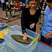 Students begin adding weight to their concrete canoe.