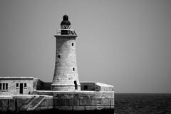 Lighthouse (deejay.castillo) Tags: monochrome lighthouse sea malta black white contrast
