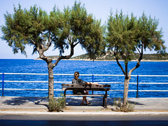 Who's that lady? (Neal.) Tags: crete seat 9 agiosnikolaos sea wife eileen mosquito bits trees bench greece holiday