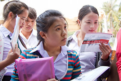 Laos: Increasing Opportunities for Women (World Bank Photo Collection) Tags: girls look youth standing reading stand education women asia university looking group young read leaflet brochure gender worldbank schooluniform vientiane eastasia highereducation genderequality opendata laopdr universityoflaos
