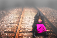 Damsel (Tonia Mc Caskill-Johnson Photography) Tags: woman fog train dark quiet purple tracks atmosphere hood drape cloak heavy stillness thick damsel blackcloak hooded cs4 niksoftware nikond700 womanontraintracks