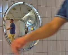 underground bend (sharp capture) Tags: people blur reflection london walking mirror movement nikon arm tube tubestation londonunderground nikkor nikon50mm18 nikond7100