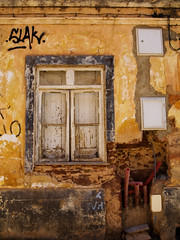 'Some minor decorating required' (steverichard) Tags: old travel urban house holiday building home portugal window yellow wall ventana graffiti wooden warm europe closed exterior forsale hole image pipe explore shutters damage graffito wreck ochre estoi fenetre slak vendese fixerupper 2013 steverichard