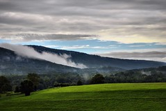 Low-Lying Clouds at Sauratown Mountains (The Kiser Guy) Tags: jordankiser thekiserguy nikon d5000 moutain mountains field fields green sky landscape cloud clouds fog smoke rock hill hills rocks nature land hike hiking hillside moutainside sauratown sauratownmountains sauratownmountain range stokes surry sauras northcarolina forest cliff cliffs rockclimb rockclimbing hangingrockstatepark hangingrock statepark bluesky cloudy dx outside outdoor outdoors wallpaper background fire lowlyingclouds low