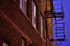 Fire escape # 15 (jimmiesp) Tags: street old winter cold color building art weather skyline architecture night stars dawn nikon downtown cityscape escape exterior bricks steps 85mm architectural sidewalk railing stpaulmn d5100