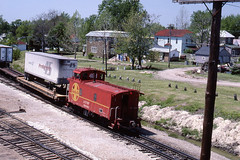 Santa Fe caboose trails a westbound through Marceline  MO on 5/18/84 (LE_Irvin) Tags: santafe caboose marcelinemo