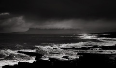 Stormy Shore, Co Sligo, Ireland. (2c..) Tags: ireland sea bw seascape 20d silhouette skyscape evening moody 2c cmwdyellow therebeastormabrewin 72dpipreview lowresolutionpreview 2c vision:outdoor=0881 vision:sky=0516 2cireland