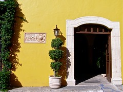 For a great meal in Izamal, Yucatan, near the pyramid Kinich Kakmo. . . . . (Melinda Stuart) Tags: shadow food sun building tree yellow stone architecture mexico restaurant maya colonial masonry yucatan container doorway noon izamal tipico 2013 kinich mayafieldworkshops