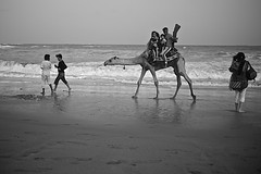 click.. (camelot98.) Tags: ocean street leica sea people blackandwhite bw beach water monochrome seaside sand waves candid streetphotography camel karachi vignette arabiansea thephotographyblog vision:outdoor=0974 vision:ocean=0829 vision:sky=0845