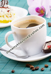 Coffee cup and milk chocolate candy  closeup (Olena Mykhaylova) Tags: morning food brown white black orchid flower cup coffee closeup table dessert cuisine break flavor candy drink sweet chocolate coffeecup cream plate bean gourmet delicious snack sweets leisure saucer aroma nutrition coffeebean