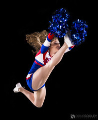 Cheerleader In Flight (dougsooley) Tags: cheer cheerleader cheerleaders sports sport sportsphotography sportsphotographer sportsaction actionshots canon canon1dx actionsports sigma sigmalens sigmalenses sigma50mm14 sigmaart strobes strobist strobe