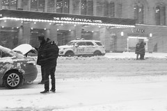 Are you sure your journey is strictly necessary, sir? (marktmcn) Tags: new york snowstorm snow storm nyc blackandwhite snowing heavily heavy street scene streetscene snowscene taxi nypd dsc rx100
