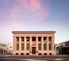 Different Times, Different Light: Public Trust Office (ajecaldwell11) Tags: ankh light hawkesbay newzealand sunset napier publictrustoffice architecture old sky historic building caldwell clouds dusk