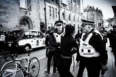You're Nicked (Duncan212) Tags: police nicked arrested marketstreet demo demonstration arrest blackandwhite blackwhite bw edinburgh streetphotography street gritty bike taxi
