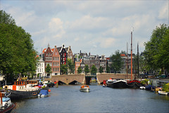 Postcard from Amsterdam (angelsgermain) Tags: canal bridge boats water buildings houses sky trees summer city amsterdam northholland thenetherlands