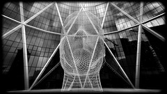 Calgary Bow Tower Art (lowebowes) Tags: declined blackandwhite architecture art metal artistic reflections triangles contemporary hdr hdrphotography pano panorama photomerge bw calgary bowtower artwork